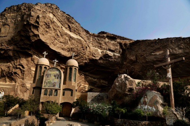 A general view of the Cave Cathedral or St. Sama'ans Church on the Mokattam hills overlooking Cairo, Egypt, Tuesday, Aug. 30, 2016. (AP Photo/Nariman El-Mofty)