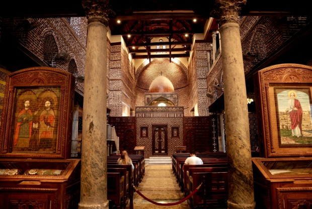 A man and woman pray at the Cavern Church, and the martyrs Sergius and Bacchus, famously known as the Abu Serga Church, in Old Cairo, Egypt, Tuesday, Aug. 30, 2016. (AP Photo/Nariman El-Mofty)