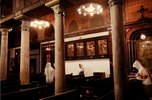 Ethiopian women visit the Coptic Hanging Church in Old Cairo, Egypt, Sunday, Aug. 28, 2016. (AP Photo/Nariman El-Mofty)