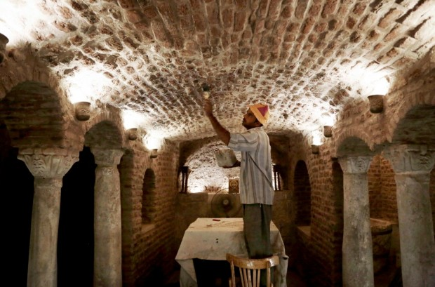 A worker renovates part of the Cavern Church, and the martyrs Sergius and Bacchus, famously known as the Abu Serga Church in Old Cairo, Egypt, Tuesday, Aug. 30, 2016. (AP Photo/Nariman El-Mofty)